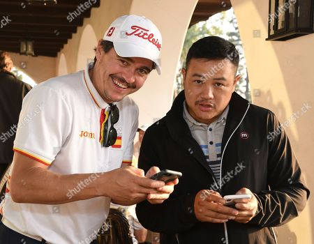 Arturo del Puerto, Jonathan Huang. Arturo del Puerto, left, and Jonathan Huang attend the 19th Annual Emmys Golf Classic at the Wilshire Country Club on in Los Angeles