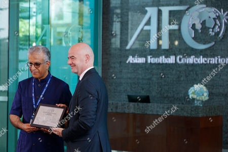 Asia Football Confederation President Salman Bin Ibrahim Al-Khalifa, left, presents a souvenir to FIFA President Gianni Infantino during an inauguration ceremony for the new building of the Asia Football Confederation in Kuala Lumpur, Malaysia