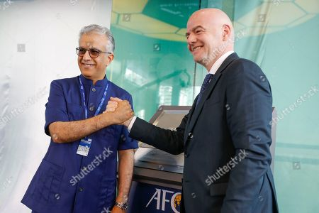 Gianni Infantino, Salman Bin Ibrahim Al-Khalifa. Asia Football Confederation President Salman Bin Ibrahim Al-Khalifa, left, poses with FIFA President Gianni Infantino during an inauguration ceremony for the new building of the Asia Football Confederation in Kuala Lumpur, Malaysia