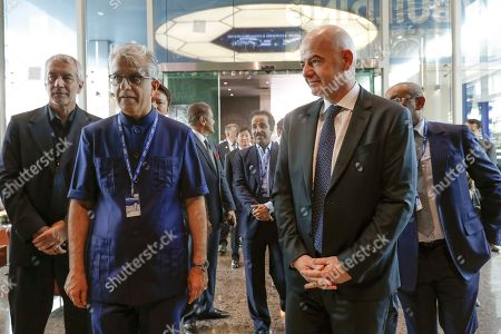 Asia Football Confederation President Salman Bin Ibrahim Al-Khalifa, front left, walks with FIFA President Gianni Infantino, front right, during an inauguration ceremony for the new building of the Asia Football Confederation in Kuala Lumpur, Malaysia