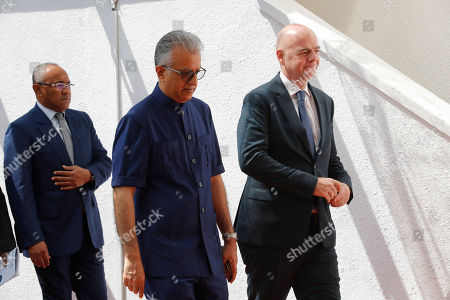 Salman Bin Ibrahim Al-Khalifa, Gianni Infantino. Asia Football Confederation President Salman Bin Ibrahim Al-Khalifa, center, walks with FIFA President Gianni Infantino, right, as they arrive for an inauguration ceremony for the new building of the Asia Football Confederation in Kuala Lumpur, Malaysia