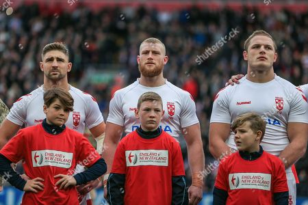 Tommy Makinson of England (L) Luke Thompson of England (C) and George Burgess of England (R) line up before kick-off