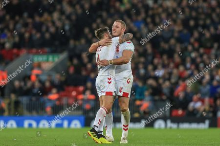 Oliver Gildart of England gives Tom Burgess of England a hug as England win the game 20-14