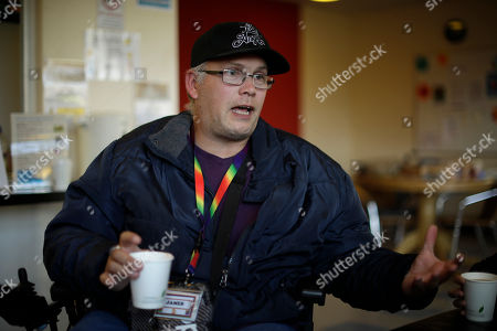 Support worker James Fox speaks as he is interviewed by The Associated Press at the Ivybridge estate community centre in west London, . Much of Britain will continue to feel the effects of eight years of spending cuts, even after the government's Treasury chief heralded the end of austerity by splashing out billions of pounds for health, transportation and small business in his latest budget