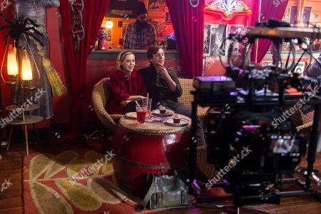 Kiernan Shipka as Sabrina Spellman, Ross Lynch as Harvey Kinkle