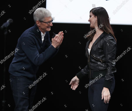 Stock Photo of Apple CEO Tim Cook (L) and US singer Lana Del Ray during an Apple special event at the Howard Gilman Opera House at the Brooklyn Academy of Music before the start of an Apple event in New York, New York, USA, 30 October 2018. The event follows soon after a major Apple iPhone product launch in September 2018.
