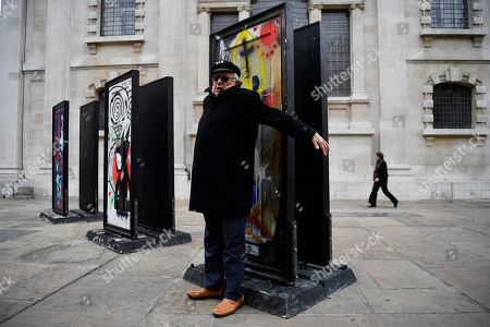 British artist Ralph Steadman poses with his work forming part of the installation A Year Outdoors at St Martin's In the Field in London, Britain, 30 October 2018. The work features ten reclaimed front doors painted by a variety of artists which were originally hung across the streets of Bristol.
