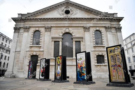 The installation A Year Outdoors is displayed at St Martin's in the Field in London, Britain, 30 October 2018. The work features ten reclaimed front doors painted by a variety of artists which were originally hung across the streets of Bristol.