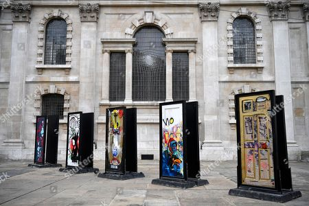 Stock Photo of The installation A Year Outdoors is displayed at St Martin's in the Field in London, Britain, 30 October 2018. The work features ten reclaimed front doors painted by a variety of artists which were originally hung across the streets of Bristol.