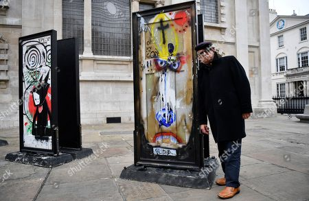 Stock Picture of British artist Ralph Steadman poses with his work forming part of the installation A Year Outdoors at St Martin's In the Field in London, Britain, 30 October 2018. The work features ten reclaimed front doors painted by a variety of artists which were originally hung across the streets of Bristol.