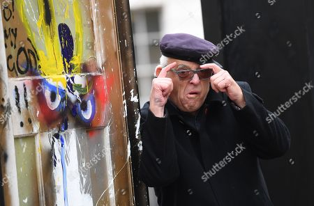 Stock Image of British artist Ralph Steadman poses during g a photo call for the installation A Year Outdoors at St Martin's in the Field in London, Britain, 30 October 2018. The work features ten reclaimed front doors painted by a variety of artists which were originally hung across the streets of Bristol.