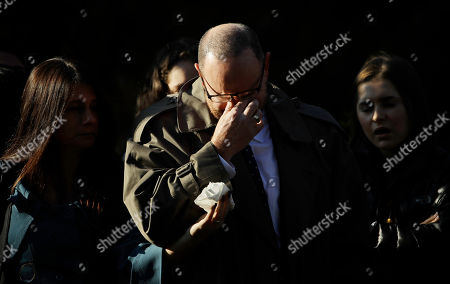 A mourner reacts outside Rodef Shalom Congregation before the funeral services for brothers Cecil and David Rosenthal, in Pittsburgh. The brothers were killed in the mass shooting last week at the Tree of Life Synagogue