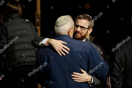 Mourners hug outside Rodef Shalom Congregation during the funeral services for brothers Cecil and David Rosenthal, in Pittsburgh. The brothers were killed in the mass shooting Saturday at the Tree of Life synagogue