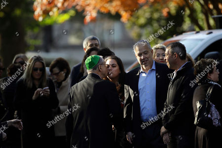Mourners gather outside Rodef Shalom Congregation before the funeral services for brothers Cecil and David Rosenthal, in Pittsburgh. The brothers were killed in the mass shooting Saturday at the Tree of Life synagogue
