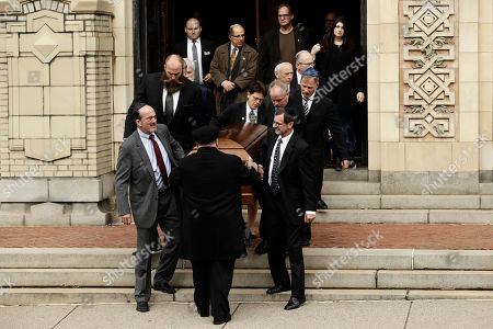 Stock Image of A casket is carried out of Rodef Shalom Congregation after the funeral services for brothers Cecil and David Rosenthal, in Pittsburgh. The brothers were killed in the mass shooting last week at the Tree of Life Synagogue