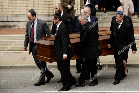 A casket is carried out of Rodef Shalom Congregation after the funeral services for brothers Cecil and David Rosenthal, in Pittsburgh. The brothers were killed in the mass shooting last week at the Tree of Life Synagogue