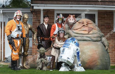 Luke Kaye with his sons Josh (centre) and Bradley. They are pictured with replica's of C3PO, R2D2, Jabba the Hutt and Yoda