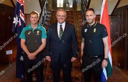 (L-R) Australia's cricket captain George Bailey, Australian Prime Minister Scott Morrison and South Africa's cricket captain Faf du Plessis pose for a photograph at the Prime Minister's XI cricket reception at The Lodge in Canberra, Australian Capital Territory, Australia, 30 October 2018. Australia and South Africa will play in the ODI series starting 04 November 2018.