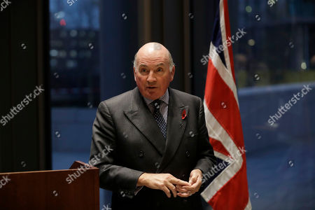 Stock Image of British General Lord Richard Dannatt, the retired former Chief of the General Staff, the head of the British army, speaks at the unveiling of two 6 foot 'Tommy' figures purchased from the 'There But Not There' campaign to commemorate the upcoming centenary of the end of World War I at the U.S. Embassy in London, . World War I ended on November 11, 1918 and 'There But Not There' is the 2018 Armistice project for the charity Remembered
