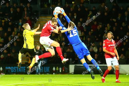 Burton Albion midfielder Jamie Allen (4), Nottingham Forest goalkeeper Luke Steele (15) and Nottingham Forest defender Michael Dawson (20) challenge for the ball during the EFL Cup match between Burton Albion and Nottingham Forest at the Pirelli Stadium, Burton upon Trent