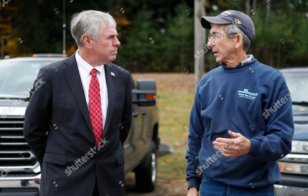 Shawn Moody, Jeff Simpson. Shawn Moody, left, Republican candidate for Maine governor, talks with Jeff Simpson during a campaign visit to Simpson's mulch and recycling business, in Sanford, Maine. Moody is running against Democrat Janet Mills and independent Terry Hayes