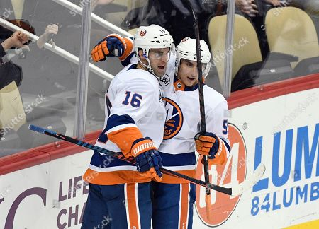 New York Islanders left wing Andrew Ladd (16) celebrates with New York Islanders center Valtteri Filppula (51) after scoring a goal against the Pittsburgh Penguins during the first period of an NHL hockey game in Pittsburgh
