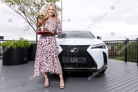 Stock Picture of Emma Freedman holds the Lexus Melbourne Cup in Lexus ahead of the Melbourne Cup Carnival in Melbourne, Australia, 31 October 2018.