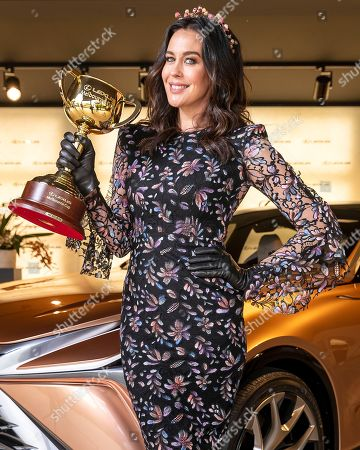 Megan Gale is seen holding the Lexus Melbourne Cup in Lexus ahead of the Melbourne Cup Carnival in Melbourne, Australia, 31 October 2018.