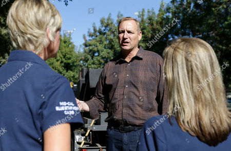 Rep. Jeff Denham talks with Blue Star Mothers Lori Prins, left, and Stacy Fournet, right, during his appearance at the 3rd Annual Veterans Stand Down in Modesto, Calif. Denham, a Republican, is being challenged by Democrat Josh Harder for the California 10th Congressional District seat in the November election