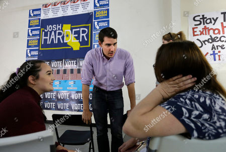 Stock Picture of Josh Harder the Democratic candidate for the California 10th Congressional District, talks with supporters Rebecca, left, and Michelle Tennell, right, in Modesto, Calif. Harder is trying to unseat incumbent Republican Rep. Jeff Denham for the 10th Congressional District seat in the November election
