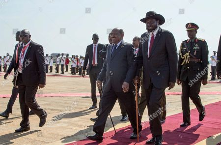 Omar al-Bashir, Salva Kiir. Sudan's President Omar al-Bashir, center, walks with South Sudan's President Salva Kiir, center right, as he arrives at the airport in Juba, South Sudan . For the first time since fleeing the war-torn country more than two years ago, South Sudan's opposition leader Riek Machar returned on Wednesday to take part in a nationwide peace celebration