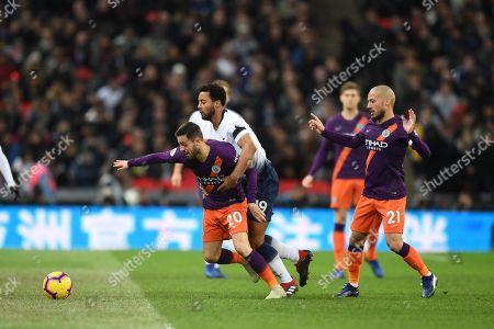 Mousa Dembele holds back Bernardo Silva