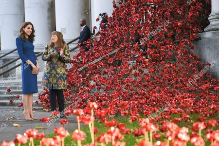 Stock Photo of Catherine Duchess of Cambridge with the 'Poppies: Weeping Window' artwork by Paul Cummins and Tom Piper