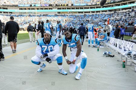 Devin Funchess, Trai Turner. Carolina Panthers wide receiver Devin Funchess (17) and Carolina Panthers offensive guard Trai Turner (70) pose for photographers in the forth quarter of an NFL football game against the Baltimore Ravens in Charlotte, N.C