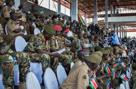 South Sudanese security forces attend peace celebrations in the capital Juba, South Sudan . For the first time since fleeing South Sudan more than two years ago, opposition leader Riek Machar returned on Wednesday to take part in a nationwide peace celebration