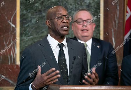 Edwin Moses, Jim Carroll. Edwin Moses, chairman of the U.S. Anti-Doping Agency, left, joined by Jim Carroll, deputy director of the Office of National Drug Control Policy, speaks a news conference during a White House event aimed at reforming the World Anti-Doping Agency, in Washington