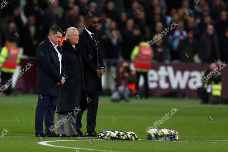 After laying wreaths, David Gold, Tone Cottee and Ledley King observe a minutes silence for the Leicester air crash victims before West Ham United vs Tottenham Hotspur, Caraboa Cup Football at The London Stadium on 31st October 2018