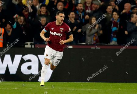 West Ham United's Winston Reid celebrates after scoring his side's opening goal during the English League Cup 4th round soccer match between West Ham United and Tottenham Hotspur at the London stadium in London