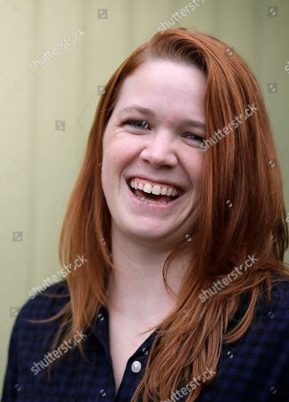 House candidate Sarah Smith poses for a photo in Seattle. Smith thought her campaign to unseat longtime Rep. Adam Smith might receive a lot more attention after little-known Alexandria Ocasio-Cortez upset a 10-term incumbent in New York last summer. Like Ocasio-Cortez, Sarah Smith is a young woman, a political newcomer and a Bernie Sanders-supporting Democratic Socialist challenging an entrenched fellow Democrat