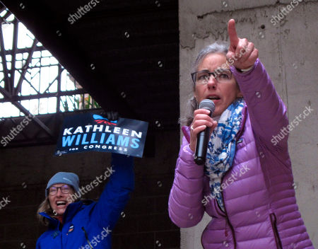 Democratic U.S. House candidate Kathleen Williams leads a crowd in a cheer during a rally in Helena, Mont., on . Williams is trying to unseat Republican Rep. Greg Gianforte in Tuesday's election
