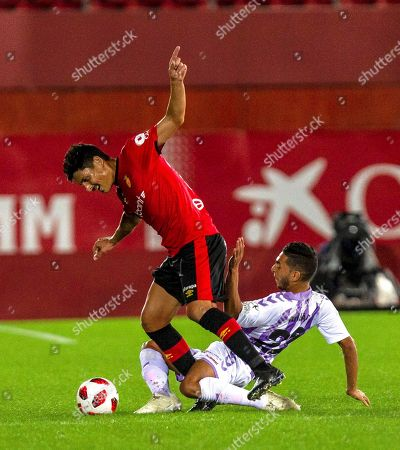 Mallorca's Argentinean midfielder Alejandro Faurlin (L) in action against Anuar Mohamed (R) of Valladolid during a Spanish King's Cup fourth round, first leg soccer match between Mallorca and Valladolid played in Palma de Mallorca, Balearic Islands, Spain, 31 October 2018.