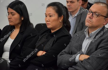 In this photo provided by Peru's Supreme Court communications office, former Peruvian first daughter Keiko Fujimori sits in court where Judge Richard Concepcion ruled that she should be detained as a preventative measure while prosecutors investigate allegations she led a criminal network within her party that received about $1 million in payments from Brazilian construction giant Odebrecht, in Lima, Peru, . Keiko Fujimori denies she accepted money from Odebrecht during her 2011 presidential run and has called the investigation a political witch hunt