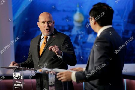 Tom MacArthur, left, the Republican candidate in the U.S. Congressional District 3 race, speaks during a debate with Democratic candidate Andy Kim, in Newark, N.J
