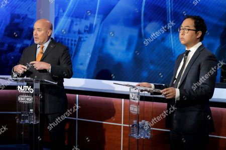 Tom MacArthur, left, Republican candidate in the U.S. Congressional District 3 race, speaks during a debate with Democratic candidate Andy Kim, in Newark, N.J
