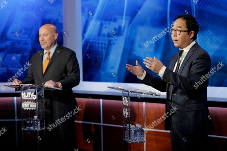 Andy Kim, right, the Democratic candidate in the U.S. Congressional District 3 race, speaks during a debate with Republican candidate Tom MacArthur, in Newark, N.J