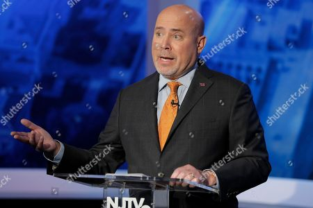 Tom MacArthur, the Republican candidate in the U.S. Congressional District 3 race, speaks during a debate with Democratic candidate Andy Kim, in Newark, N.J