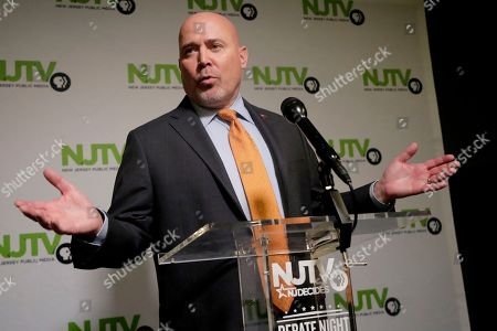 Tom MacArthur, the Republican candidate in the U.S. Congressional District 3 race, speaks to reporters after a debate with Democratic candidate Andy Kim, in Newark, N.J