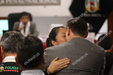 Opposition leader Keiko Fujimori (C) kisses her husband Mark Vito (R) in the National Criminal Chamber in Lima, Peru, 31 October 2018. Peruvian judge Richard Concepcion Carhuancho ordered 36 months of preventive prison for the opposition leader Keiko Fujimori in the investigation that follows her for alleged money laundering in the financing of her presidential campaign in the 2011 elections.