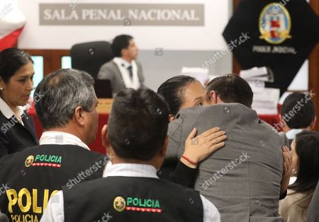 Opposition leader Keiko Fujimori (C-R) kisses her husband Mark Vito (R) in the National Criminal Chamber in Lima, Peru, 31 October 2018. Peruvian judge Richard Concepcion Carhuancho ordered 36 months of preventive prison for the opposition leader Keiko Fujimori in the investigation that follows her for alleged money laundering in the financing of her presidential campaign in the 2011 elections.