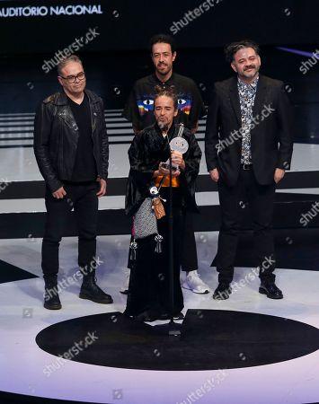 "The Mexican band Cafe Tacuba accepts the award for Best ""Grupo de Rock en Español,"" during the Lunas del Auditorio Nacional awards ceremony in Mexico City"